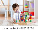 funny child playing with... | Shutterstock . vector #370972352