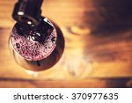 pouring red wine into the glass ... | Shutterstock . vector #370977635