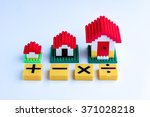 toy house with math symbol on... | Shutterstock . vector #371028218