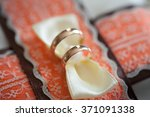 gold wedding rings on the... | Shutterstock . vector #371091338