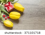Yellow Tulips On Wooden Boards...