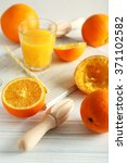 wooden juicer and orange on a... | Shutterstock . vector #371102582
