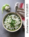 freshly made cauliflower rice... | Shutterstock . vector #371131805