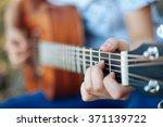 close up finger of guitarist...   Shutterstock . vector #371139722