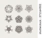 set of ornate mandala symbols.... | Shutterstock . vector #371164502