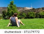 girl sitting at in the lake... | Shutterstock . vector #371179772
