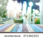 table top and blur building of... | Shutterstock . vector #371382352