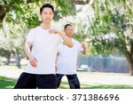 people practicing thai chi in... | Shutterstock . vector #371386696