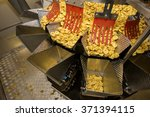 tortellini pasta production... | Shutterstock . vector #371394115