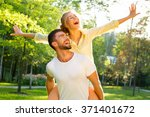 happy couple on vacation.... | Shutterstock . vector #371401672