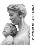 A Marble Statue Of A Mother An...