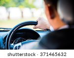 man driving a car  business