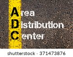 Small photo of Concept image of Business Acronym ADC AREA DISTRIBUTION CENTER written over road marking yellow paint line.