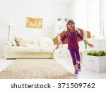 child plays in an astronaut... | Shutterstock . vector #371509762
