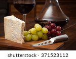 glass of red wine served from... | Shutterstock . vector #371523112