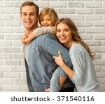 beautiful young family hugging  ... | Shutterstock . vector #371540116