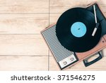 gramophone with a vinyl record... | Shutterstock . vector #371546275