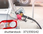 hand hold fuel nozzle to add... | Shutterstock . vector #371550142