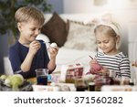 creative kids during the easter  | Shutterstock . vector #371560282