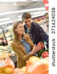 couple at the grocery store... | Shutterstock . vector #371624038
