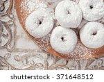 Fresh Powdered Sugar Donuts In...