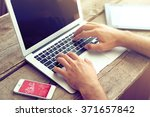 male's hands taping on laptop... | Shutterstock . vector #371657842