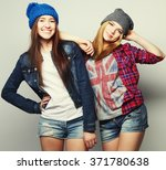 two stylish sexy hipster girls... | Shutterstock . vector #371780638