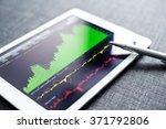 stock exchange graph on tablet... | Shutterstock . vector #371792806