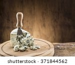 danish blue cheese on a wooden...