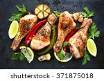 grilled spicy chicken legs on a ... | Shutterstock . vector #371875018