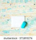 White Pad With Blue Mouse On...