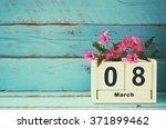 wooden march 8 calendar  next... | Shutterstock . vector #371899462