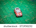 mini cooper s toy car on green... | Shutterstock . vector #371950252