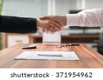shakehand of lawyer and... | Shutterstock . vector #371954962