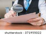laywer is analysing document...   Shutterstock . vector #371955022
