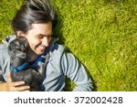 little pet dog and his owner... | Shutterstock . vector #372002428