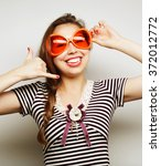 young woman with big party... | Shutterstock . vector #372012772