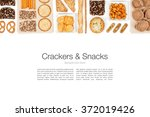 various crackers and snacks on... | Shutterstock . vector #372019426