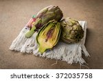 fresh sliced artichokes on a... | Shutterstock . vector #372035758