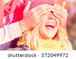 man covering eyes to young... | Shutterstock . vector #372049972