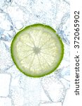 Fresh Lime Slice And Ice Cubes...