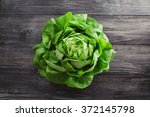 Single lettuce head over rustic ...