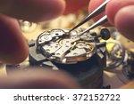 working on a mechanical watch. | Shutterstock . vector #372152722