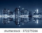 manhattan at night with... | Shutterstock . vector #372275266