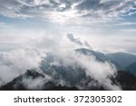 mountain in the morning mist... | Shutterstock . vector #372305302