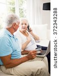 smiling senior couple using... | Shutterstock . vector #372343288