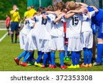 coach giving young soccer team... | Shutterstock . vector #372353308
