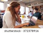 businesswoman using laptop at...   Shutterstock . vector #372378916