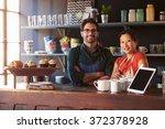 portrait of couple running... | Shutterstock . vector #372378928