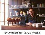 portrait of male coffee shop... | Shutterstock . vector #372379066